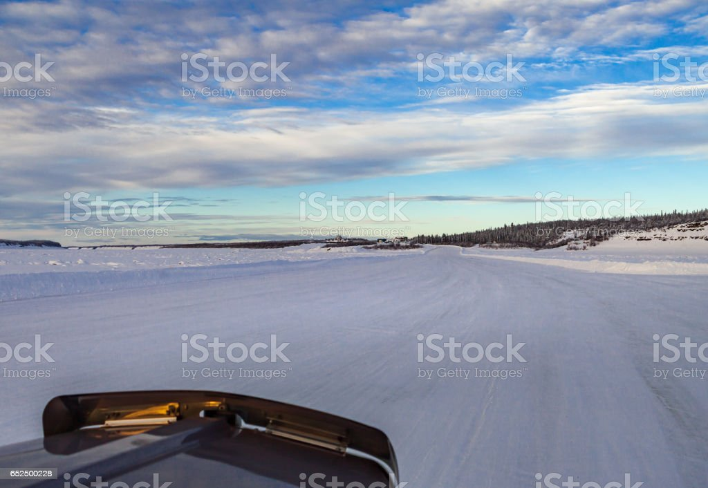 Trucking on a winter road stock photo