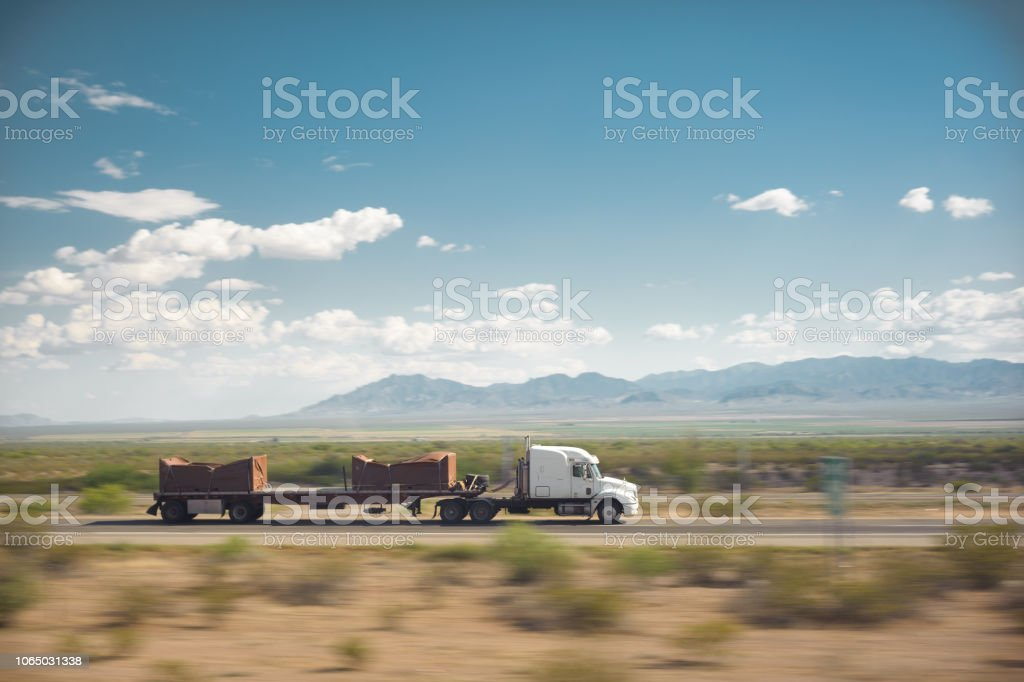 Trucking USA Desert Landscape stock photo