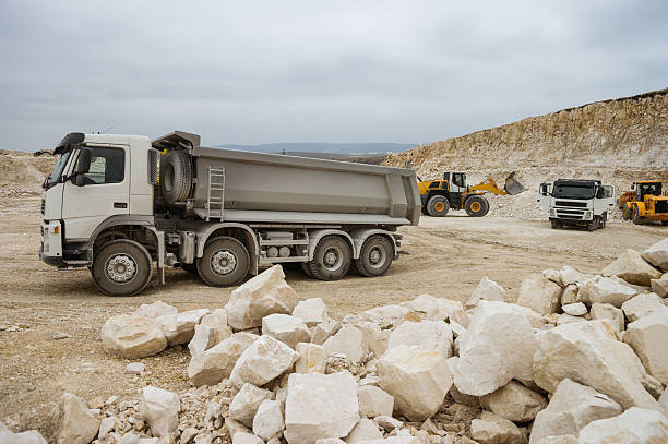 Trucks and bulldozers in quarry stock photo