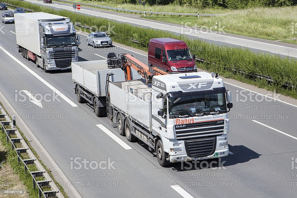 Trucks and commuters on German highway royalty-free stock photo