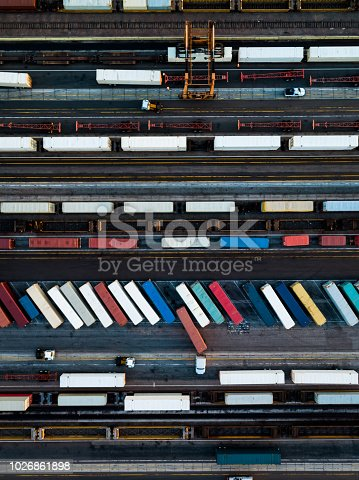 Aerial shot of an intermodal train and trucking distribution yard the city of Vernon, California. This is an industrial area surrounded by the City of Los Angeles, made up of factories, warehouses and meatpacking plants.  Top down shot looking directly down on rows of truck trailers and shipping containers, ready to be transferred between road and rail modes of transport.