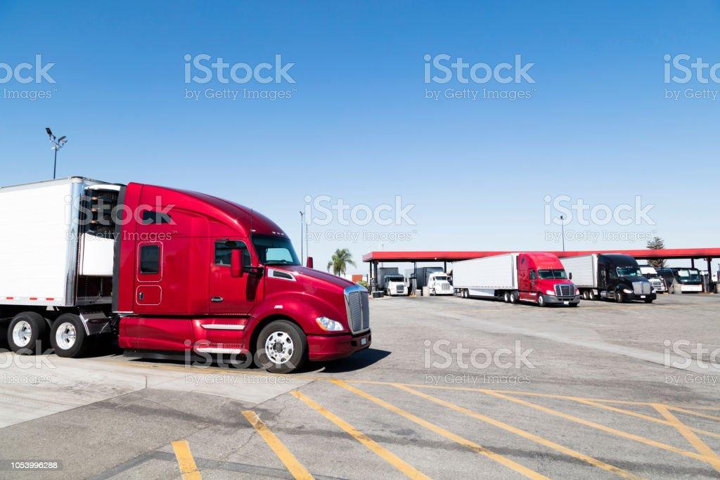 Trucks filling up at truck stop, California, USA