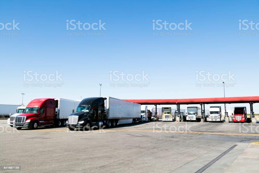 Trucks filling up at truck stop, California, USA stock photo