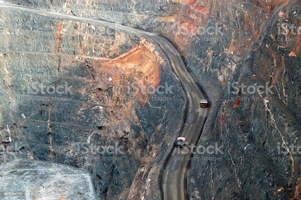 Trucks in Super Pit gold mine Australia stock photo
