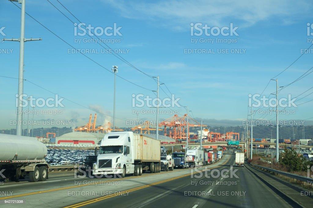 Trucks leaving Port of Tacoma stock photo
