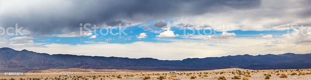 Trucks on desert highway stock photo