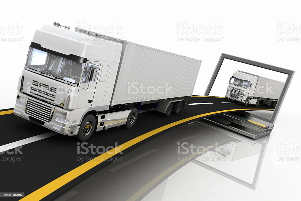 Trucks on freeway coming out of a laptop stock photo