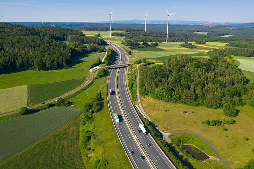 Trucks on Highway and Wind Turbines, Aerial View