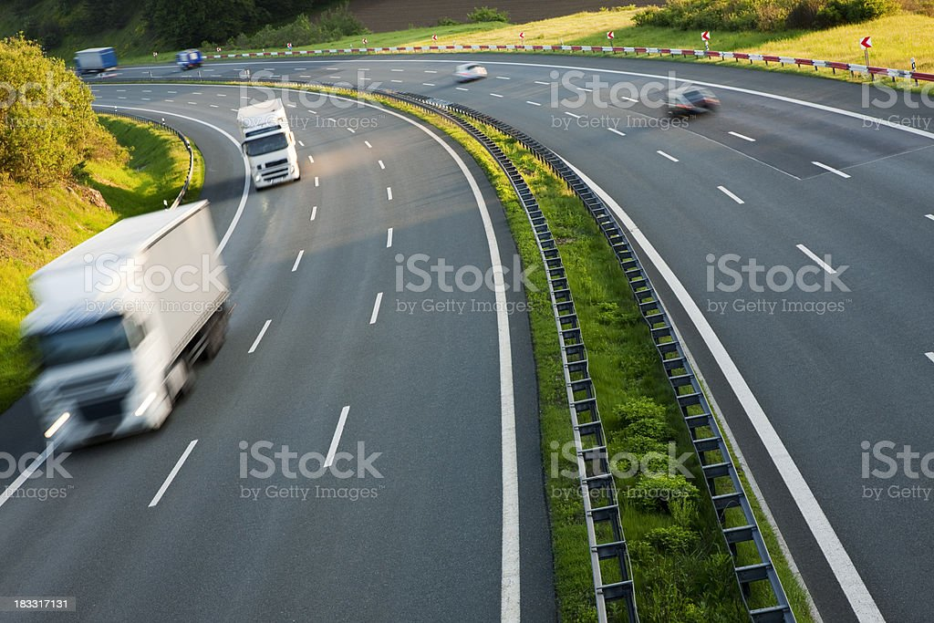 Trucks on Highway stock photo