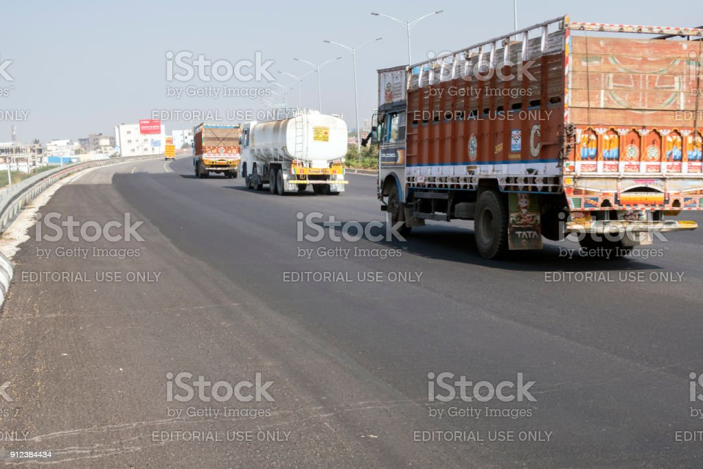 Trucks on Nehru Outer Ring Road, Hyderabad, India stock photo
