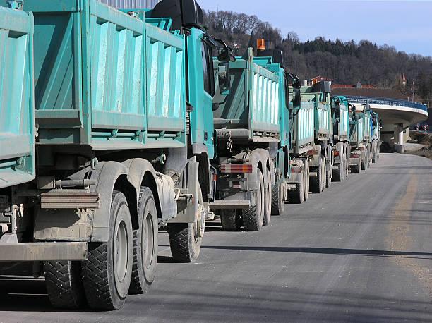 Trucks on road building – Foto