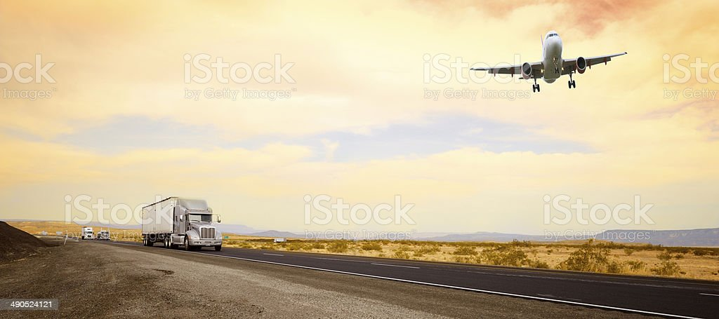 Trucks on the road and airplane, California stock photo