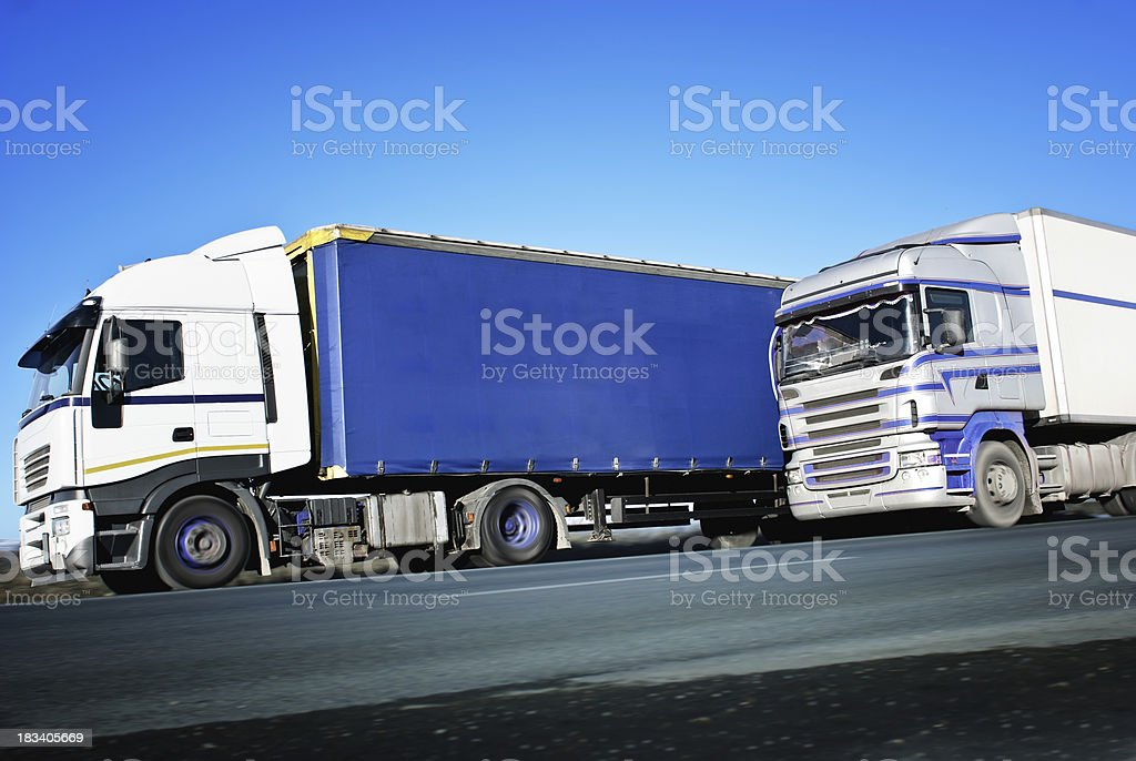 trucks on the road royalty-free stock photo