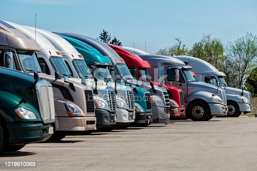 Group of trucks parked at truck stop, American transport concept, Missouri, United States.