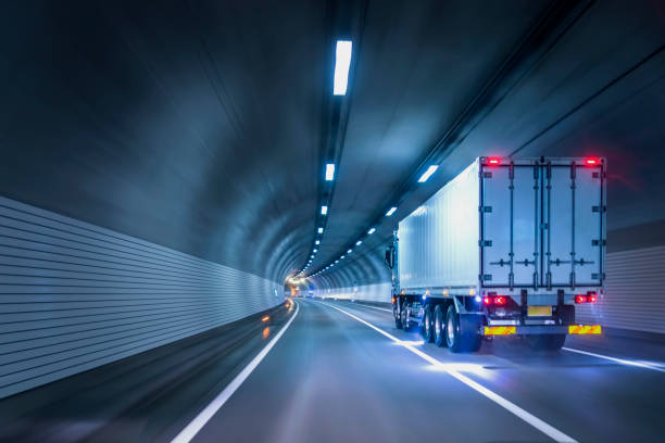 trucks passing through tunnels - logistica foto e immagini stock