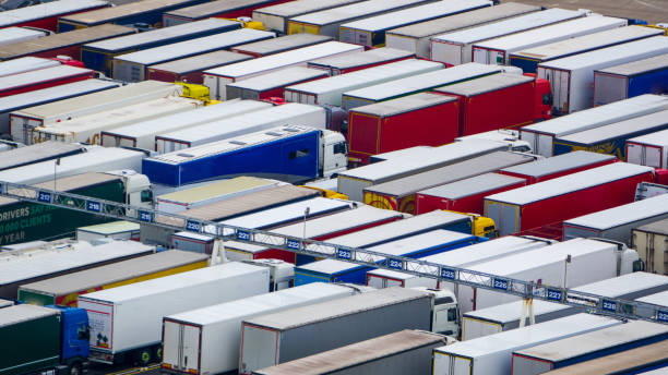trucks queuing for the channel - english channel stock pictures, royalty-free photos & images