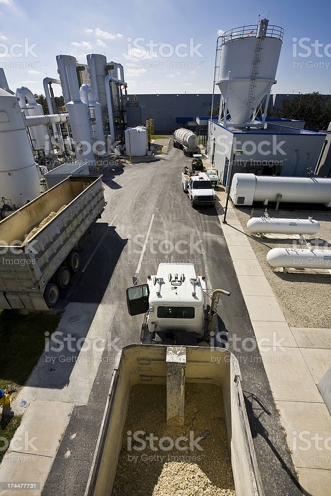 Trucks Remove Waste From Water Purification Plant stock photo