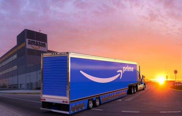 trucks with a semi-trailer with the Amazon Prime logo at the Amazon logistics center