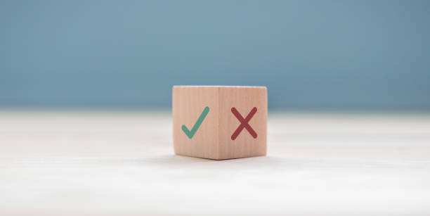 True and false symbols accept rejected for evaluation, Yes or No on wood blogs on blue background. True and false symbols accept rejected for evaluation, Yes or No on wood blogs on blue background. mistake stock pictures, royalty-free photos & images