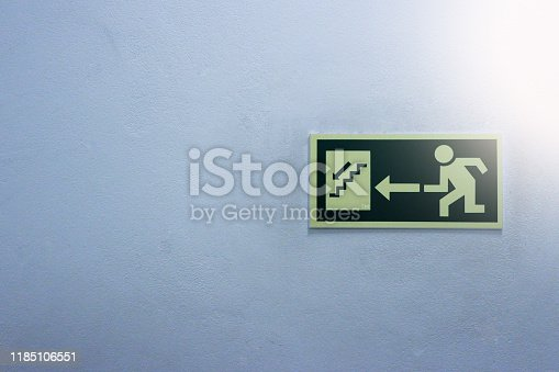 1182906669istockphoto True green safety symbol for going to the fire exit in a white background. Attached to the ground 1185106551