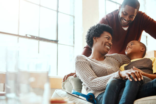 True joy when we chilling with our boy Shot of a family having fun indoors african american ethnicity stock pictures, royalty-free photos & images