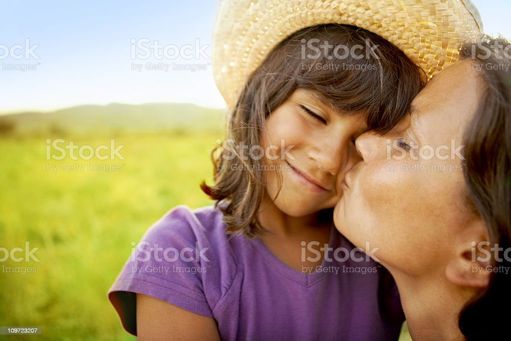 True love, mother kissing daughter royalty-free stock photo