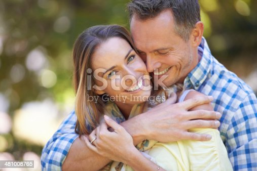 Portrait of an affectionate couple outside in the summer sun