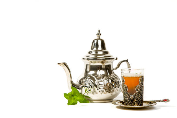 True Moroccan mint tea in the original cup True Moroccan mint tea in the original cup and teapot on the white background teapot stock pictures, royalty-free photos & images