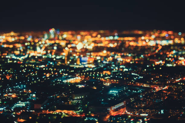 true tilt shift shooting of night city from high point - urban sprawl stock photos and pictures