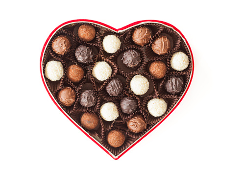 Truffles in box on white background