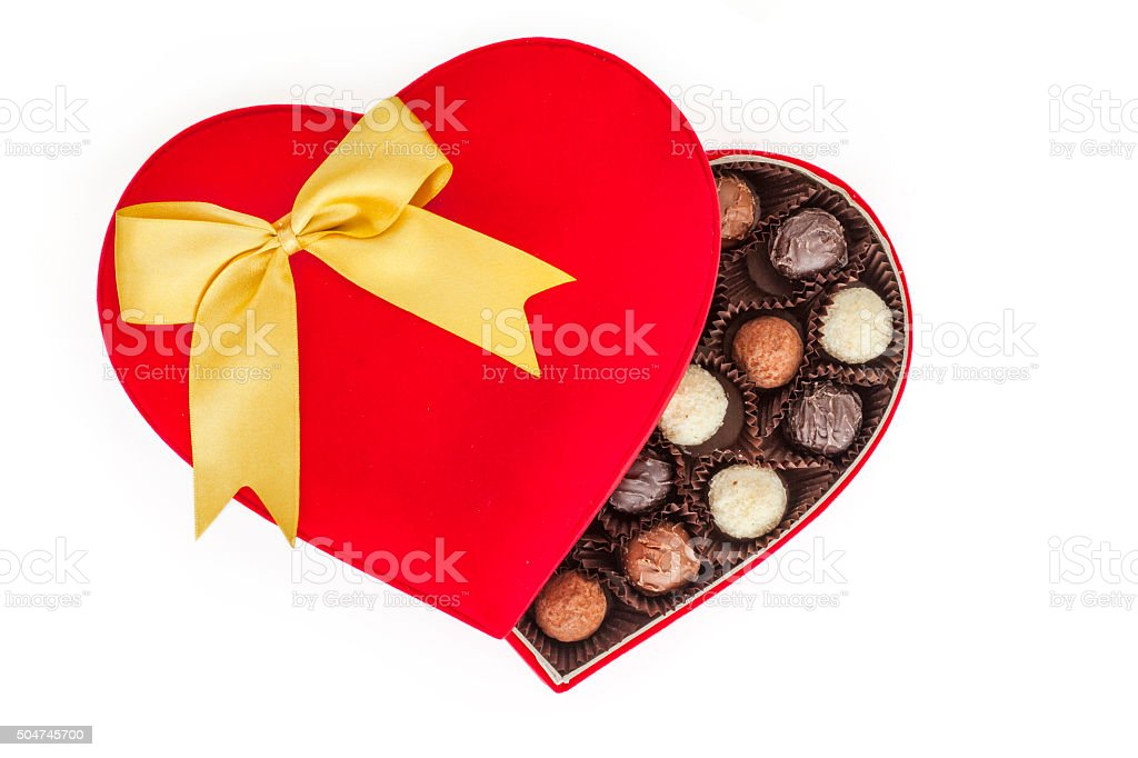Truffles in box on white background stock photo