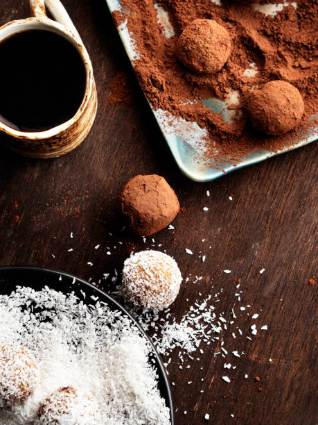 Truffles,Chocolate candies with coconut flakes,Raw chocolate tuffles,  Chocolate truffles and cocoa powder, stock photo