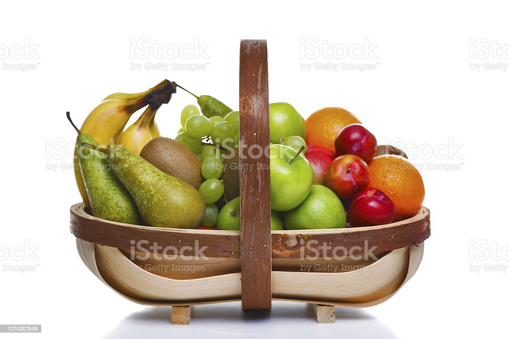 Trug full of fresh fruit isolated on white background. stock photo