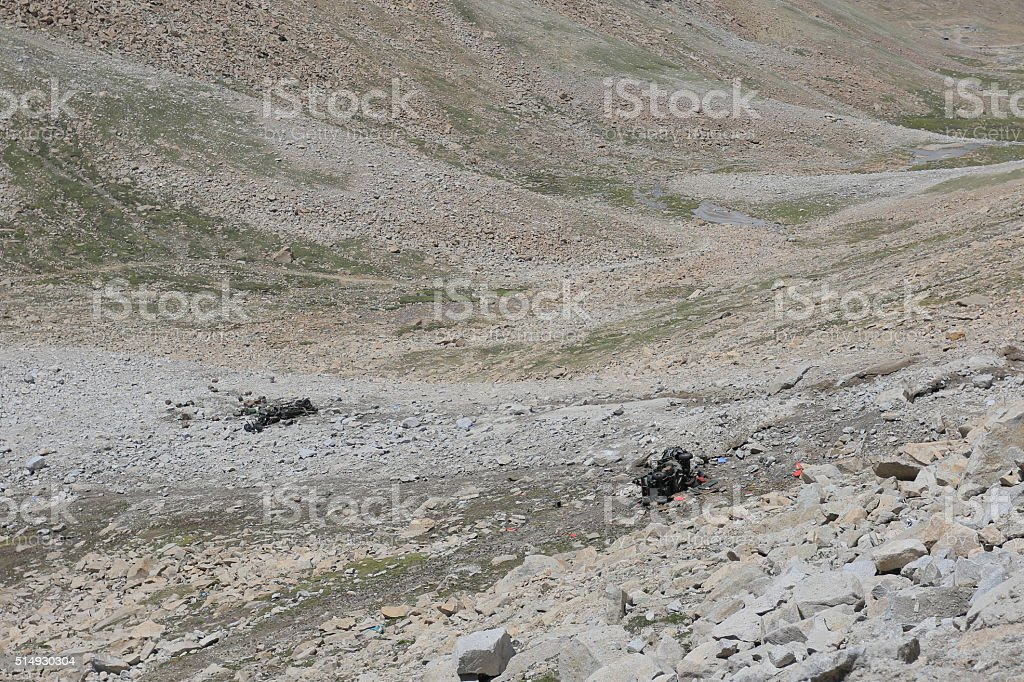 truk fall from landslide beside road to lehcity from india stock photo