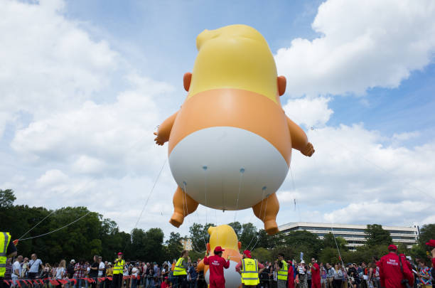 Trump Baby Blimp in the Meadows Edinburgh stock photo
