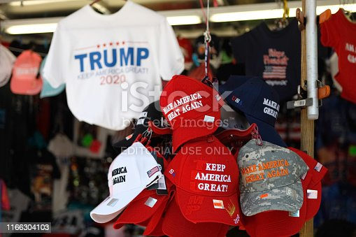 Washington, D.C., USA - July 21, 2019: A street vendor selling public domain Donald Trump paraphernalia and souvenirs. The souvenirs are located right across the street from the White House and taken on the afternoon of July 21, 2019 near Pennslyvania Avenue in Washington, D.C. The red hat is a signature symbol of his