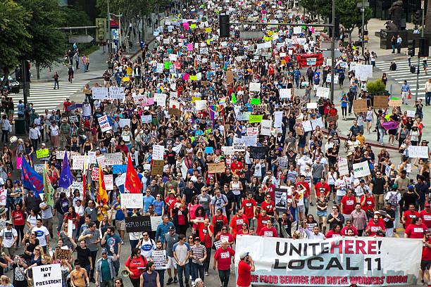 Trump Protest March, Figueroa Street Downtown Los Angeles Los Angeles, United States - November 12, 2016: Thousands of Angelenos marched through the streets of Downtown Los Angeles in protest of president-elect Donald Trump. labor union stock pictures, royalty-free photos & images