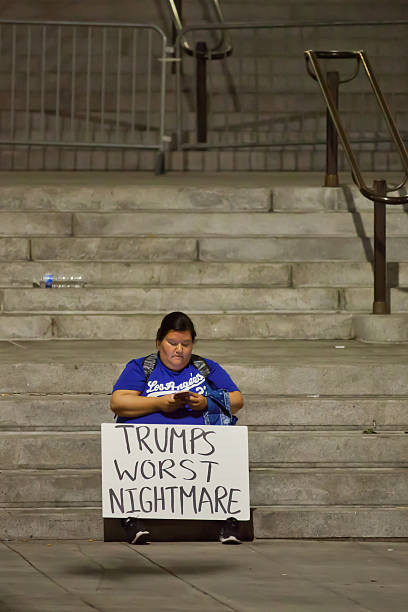 Trump Protester on City Hall stairs stock photo