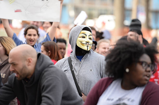 """Trump Protesters Saint Louis, MO, USA -€"""" March 11, 2016: Protesters outside a Donald Trump rally at the Peabody Opera House in Downtown Saint Louis trump mask stock pictures, royalty-free photos & images"""
