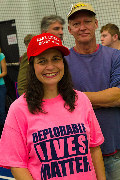 trump supporter wears deplorable lives matter shirt - deplorable stock pictures, royalty-free photos & images