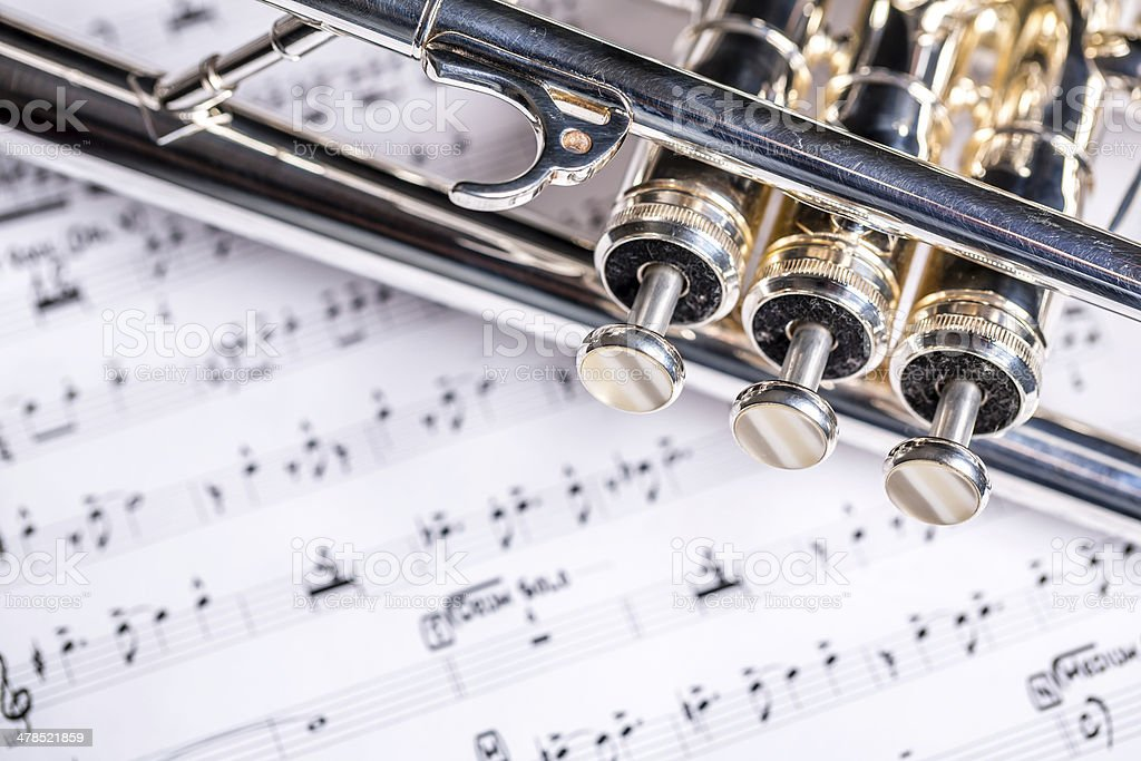 Trumpet closeup with music sheet royalty-free stock photo