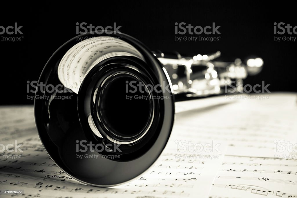 Trumpet closeup with music sheet stock photo