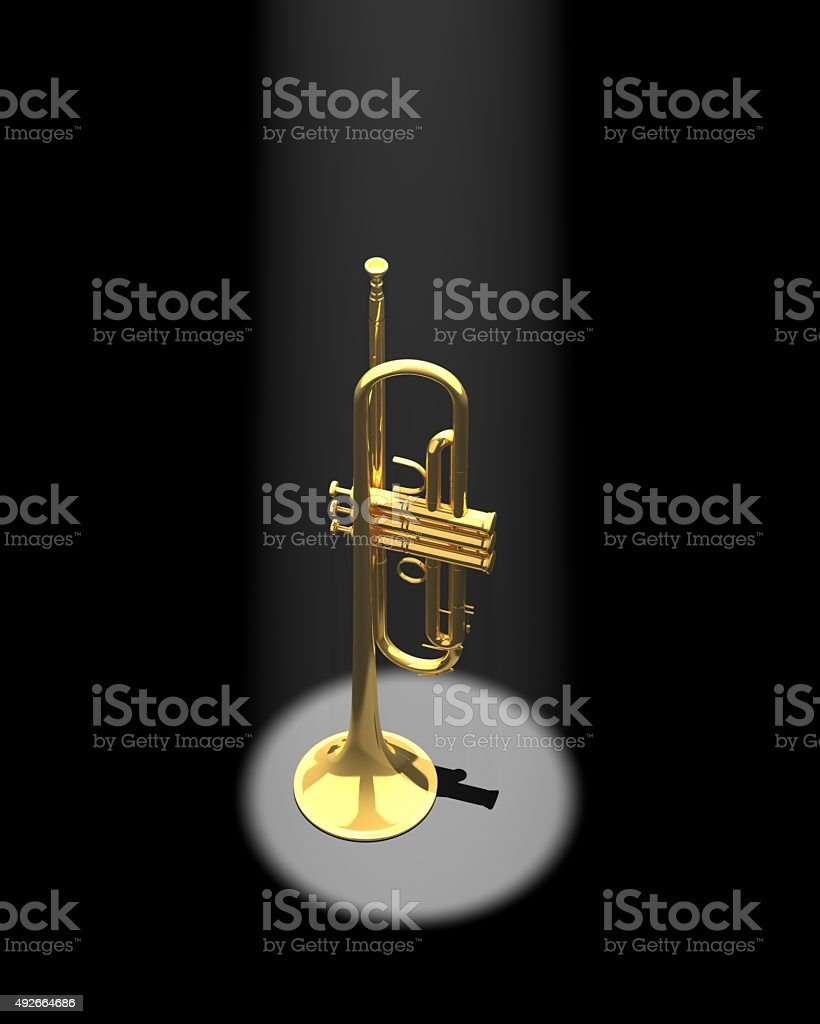Trumpet in a spotlight stock photo