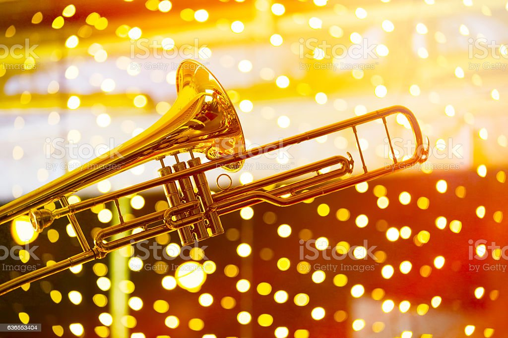 Trumpet in musical lights abstract background stock photo