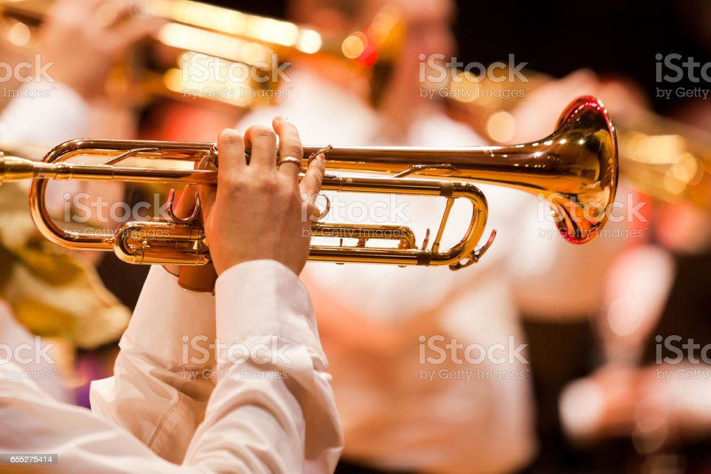 Trumpet in the hands of a musician stock photo