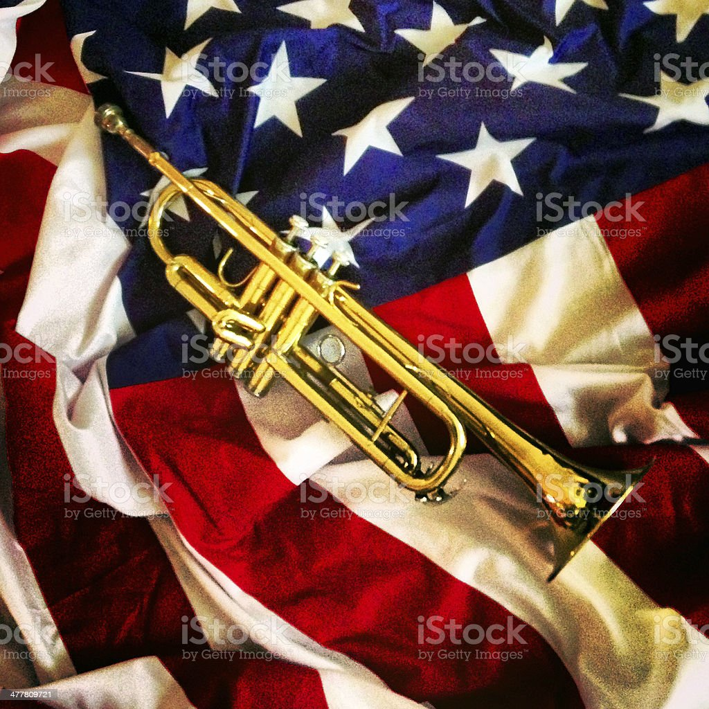 Trumpet on the US Flag royalty-free stock photo