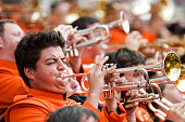 Stillwater, OK, USA - October 1, 2005: A college student plays the trumpet during a marching band performance on football field
