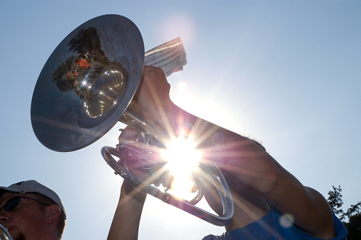 Trumpet player during marching band rehearsal on field