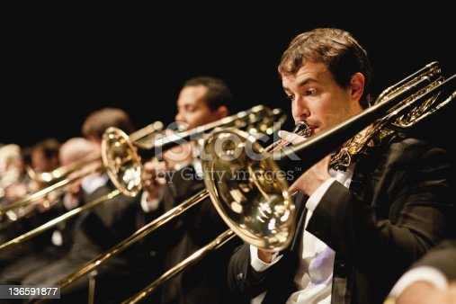 istock Trumpet players in orchestra 136591877