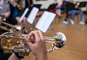 trumpet being played during a rehearsal session showing close ups of instrument